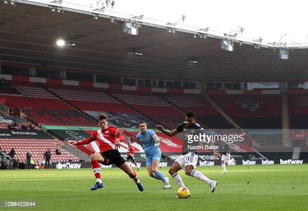 Mason Greenwood of Manchester United shoots whilst under pressure from Jannick Vestergaard of Southampton during the Premier League match between...