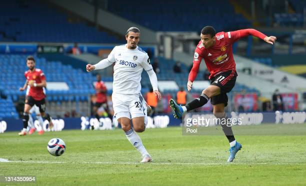 Mason Greenwood of Manchester United takes a shot whilst under pressure from Pascal Struijk of Leeds United during the Premier League match between...