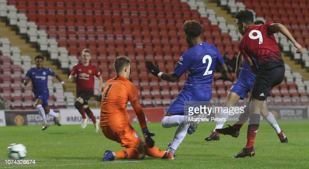 Mason Greenwood of Manchester United U18s scores their first goal during the FA Youth Cup Third Round match between Manchester United U18s and...
