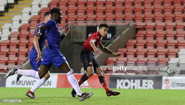 Mason Greenwood of Manchester United U18s scores their fourth goal during the FA Youth Cup Third Round match between Manchester United U18s and...