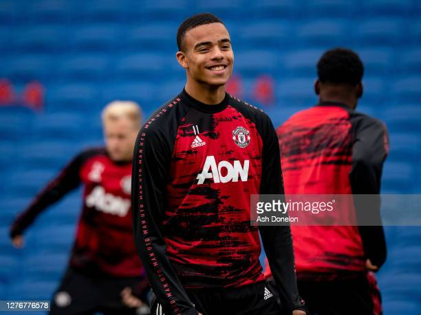 Mason Greenwood of Manchester United warms up ahead of the Premier League match between Brighton Hove Albion and Manchester United at American...