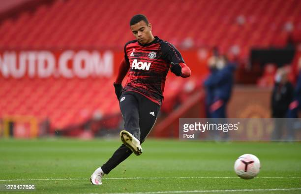 Mason Greenwood of Manchester United warms up ahead of the Premier League match between Manchester United and Tottenham Hotspur at Old Trafford on...