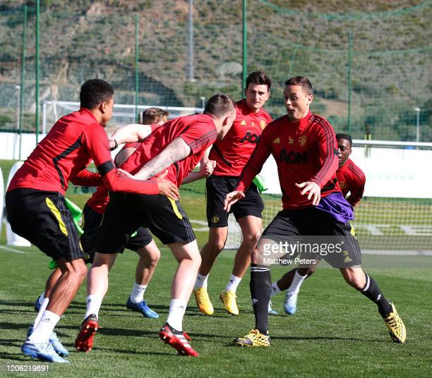 Mason Greenwood Phil Jones Harry Maguire and Nemanja Matic of Manchester United in action during a first team training session on February 14 2020 in...