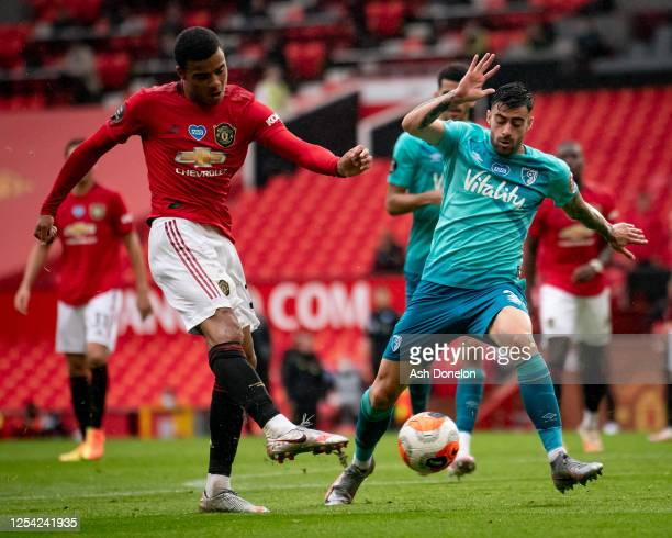 Mason Greenwood scores their fourth goal during the Premier League match between Manchester United and AFC Bournemouth at Old Trafford on July 04,...