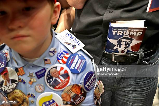 Mason Haliburton of Omaha Nebraska wears campaign buttons that he has collected from five different campaign rallies with Republican presidential...