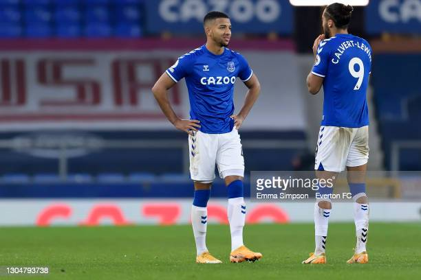 Mason Holgate and Dominic Calvert-Lewin of Everton during the Premier League match between Everton and Southampton at Goodison Park on March 2021 in...