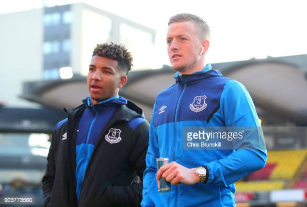 Mason Holgate and Jordan Pickford of Everton arrive ahead of the Premier League match between Watford and Everton at Vicarage Road on February 24...