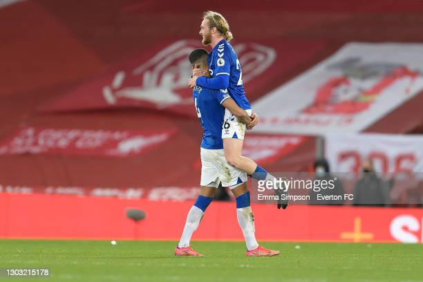 Mason Holgate and Tom Davies celebrate after the Premier League match between Liverpool and Everton at Anfield on February 20, 2021 in Liverpool,...