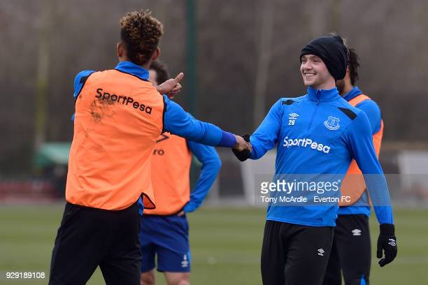 Mason Holgate and Tom Davies shake hands during an Everton FC training session at USM Finch Farm on March 6 2018 in Halewood England