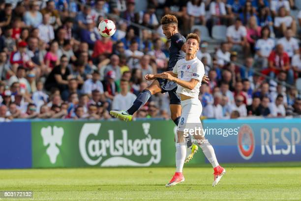 Mason Holgate of England and Martin Chrien of Slovakia battle for the ball during the 2017 UEFA European Under21 Championship match between Slovakia...