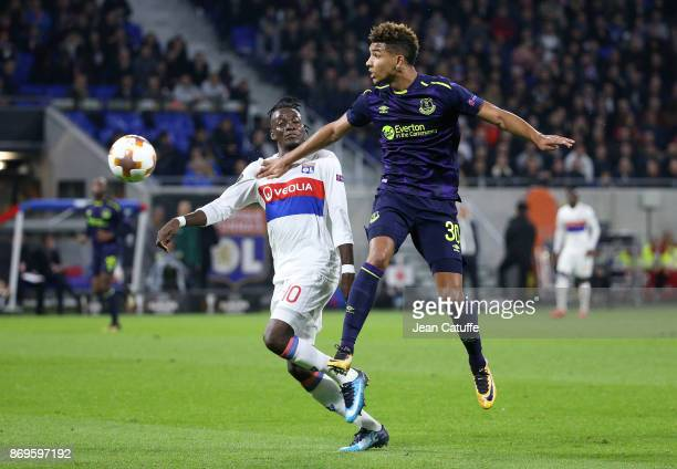 Mason Holgate of Everton and Bertrand Traore of Lyon during the UEFA Europa League group E match between Olympique Lyonnais and Everton FC at...