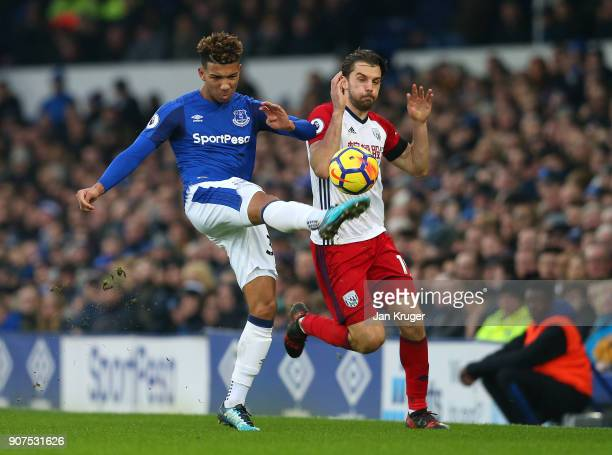 Mason Holgate of Everton and Jay Rodriguez of West Bromwich Albion battle for the ball during the Premier League match between Everton and West...