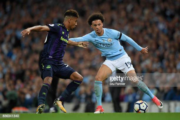 Mason Holgate of Everton and Leroy Sane of Manchester City battle for possession during the Premier League match between Manchester City and Everton...