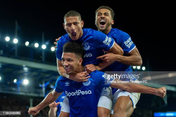 Mason Holgate of Everton celebrates a goal with team mates Richarlison and Dominic CalvertLewin during the Carabao Cup Round of 16 match between...