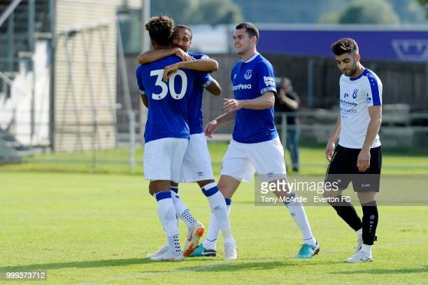 Mason Holgate of Everton celebrates his goal with Cenk Tosun and Michael Keane during the preseason friendly match between ATV Irdning and Everton on...
