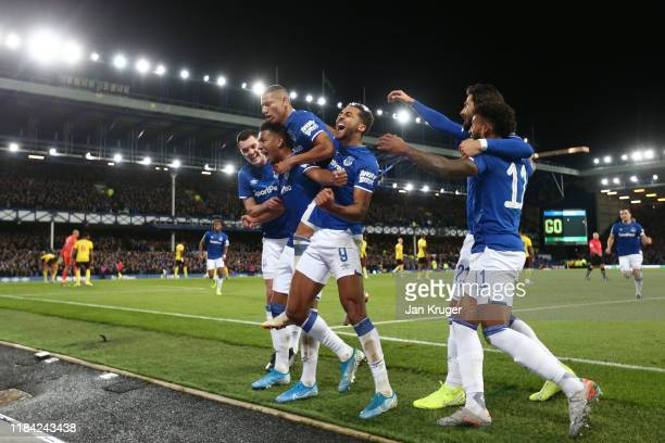Mason Holgate of Everton celebrates with teammates after scoring his team's first goal during the Carabao Cup Round of 16 match between Everton and...