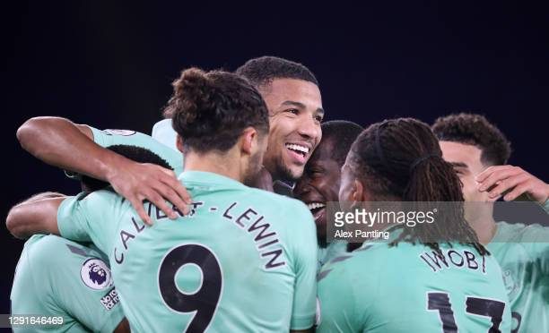 Mason Holgate of Everton celebrates with teammates Dominic Calvert-Lewin and Alex Iwobi after scoring their team's second goal during the Premier...