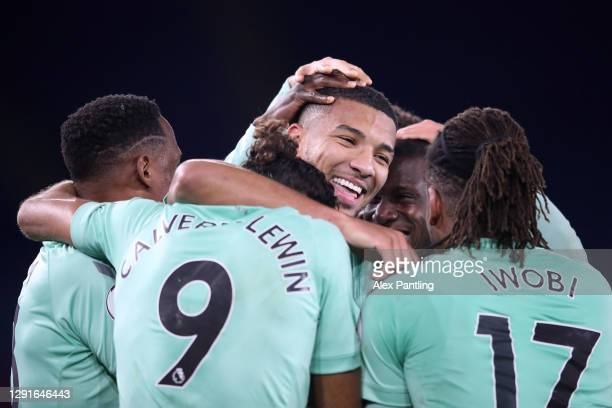 Mason Holgate of Everton celebrates with teammates Yerry Mina, Dominic Calvert-Lewin and Alex Iwobi after scoring their team's second goal during the...
