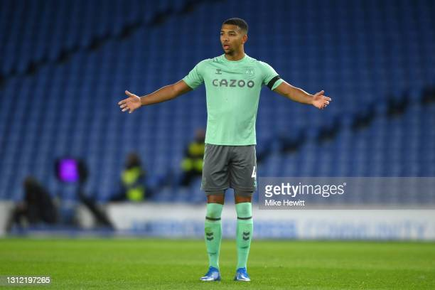 Mason Holgate of Everton gestures during the Premier League match between Brighton & Hove Albion and Everton at American Express Community Stadium on...