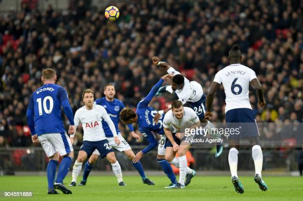 Mason Holgate of Everton in action with Serge Aurier of Tottenham Hotspur during a Premier League football match between Tottenham Hotspur and...