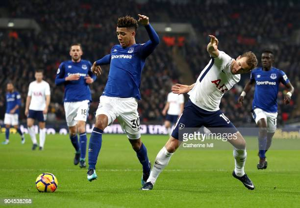 Mason Holgate of Everton is challenged by Harry Kane of Tottenham Hotspur during the Premier League match between Tottenham Hotspur and Everton at...