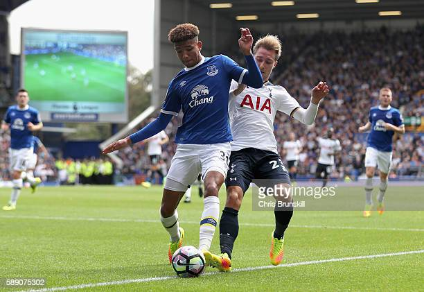 Mason Holgate of Everton is put under pressure from Christian Eriksen of Tottenham Hotspur during the Premier League match between Everton and...