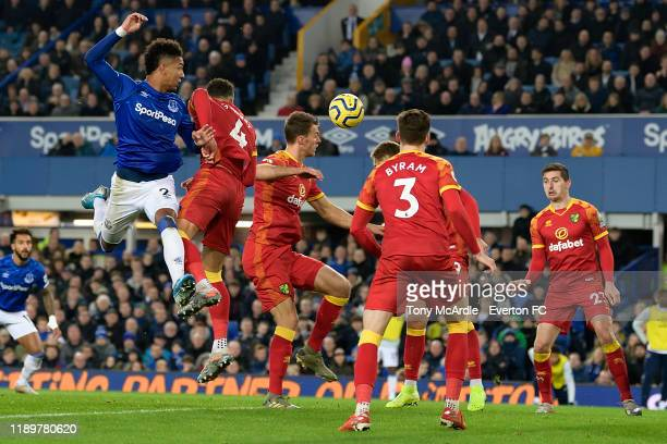 Mason Holgate of Everton jumps for a header during the Premier League match between Everton and Norwich City at Goodison Park on November 23 2019 in...