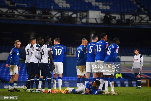 Mason Holgate of Everton lies down behind the wall before a free kick during The Emirates FA Cup Fifth Round match between Everton and Tottenham...