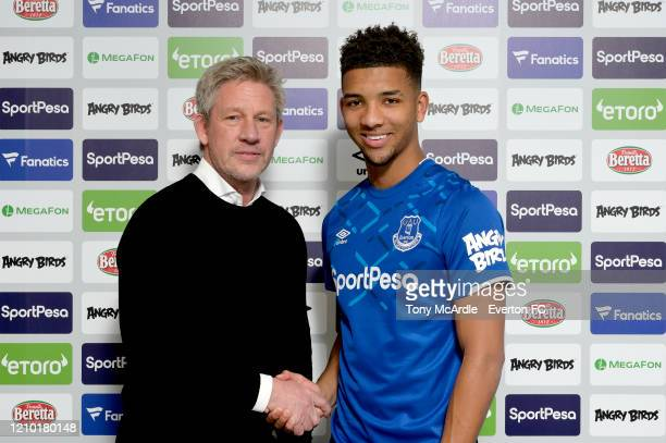 Mason Holgate of Everton poses for photo with Marcel Brands after signing a new contract at USM Finch Farm on March 3 2020 in Halewood England
