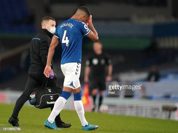 Mason Holgate of Everton receives medical treatment during the Premier League match between Everton and Tottenham Hotspur at Goodison Park on April...