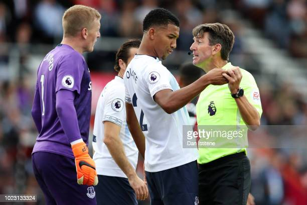 Mason Holgate of Everton speaks to the Match Referee Lee Probert during the Premier League match between AFC Bournemouth and Everton FC at Vitality...