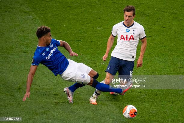 Mason Holgate of Everton tackles Giovani Lo Celso of Tottenham Hotspur during the Premier League match between Tottenham Hotspur and Everton FC at...