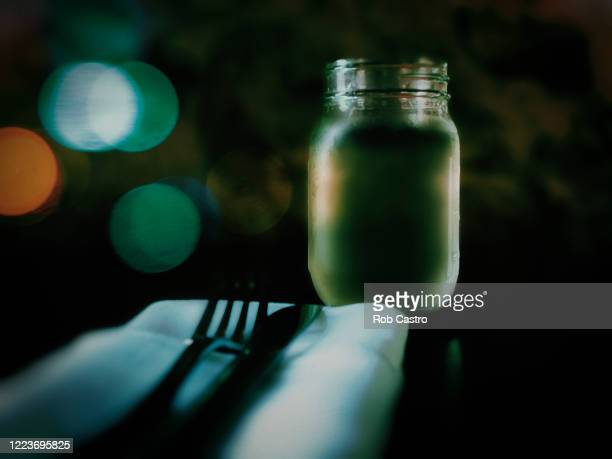 mason jar as drinking glass - rob castro stock pictures, royalty-free photos & images