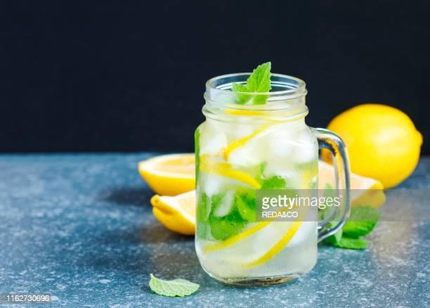 Mason jar glass of lemonade with mint. Copy space.