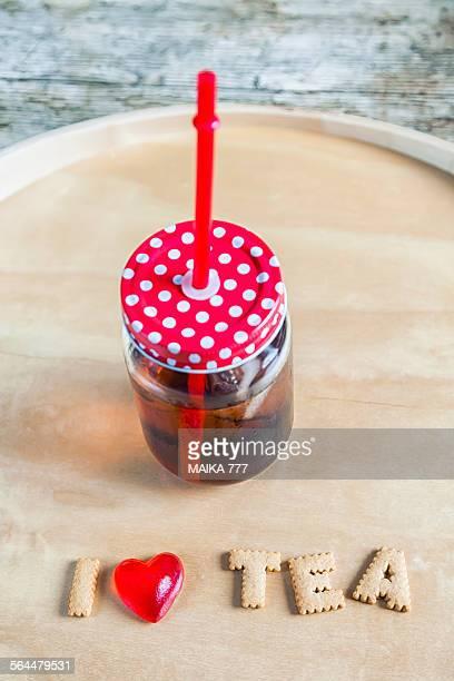 Mason jar of iced tea with straw