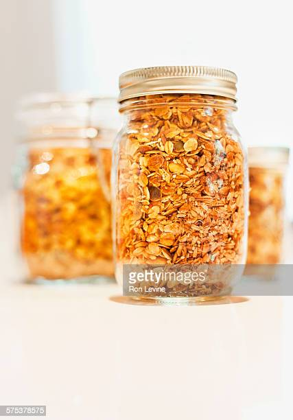 Mason jars on counter filled with granola