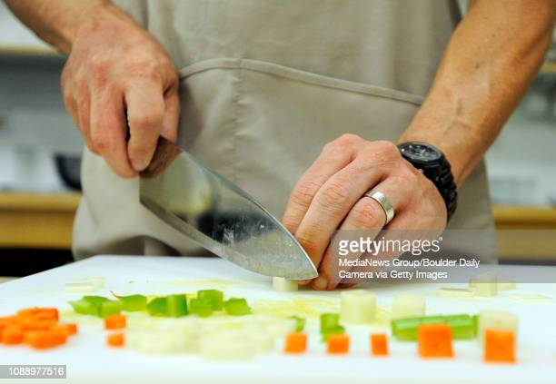 Mason Jones of Fort Lauderdale cuts carrots celery and potato cubes during a knife skills class at the Auguste Escoffier School of Culinary Arts on...