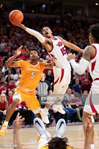 Mason Jones of the Arkansas Razorbacks goes up for a shot in the second half against Josiah-Jordan James of the Tennessee Volunteers at Bud Walton...