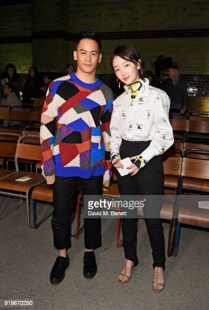 Mason Lee and Zou Dongyu wearing Burberry at the Burberry February 2018 show during London Fashion Week at Dimco Buildings on February 17 2018 in...