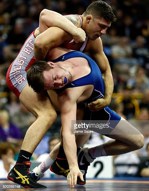 Mason Manville is thrown by Geordan Speiller during their 75kg GrecoRoman challenge match on day 2 of the 2016 US Olympic Team Wrestling Trials at...