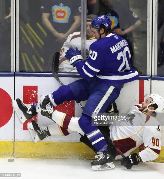 Mason Marchment levels Garret Cockerill as the Toronto Marlies play the Cleveland Monsters in game one in the second round of the Calder Cup...