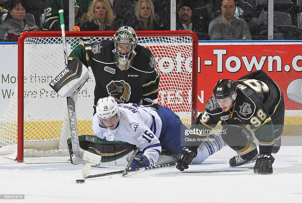 Mason Marchment #16 of the Mississauga Steelheads takes a goalie interference penalty by sliding into Tyler Parsons #1 of the London Knights during an OHL game at Budweiser Gardens on January 16,2016 in London, Ontario, Canada. The Knights defeated the Steelheads 5-0.