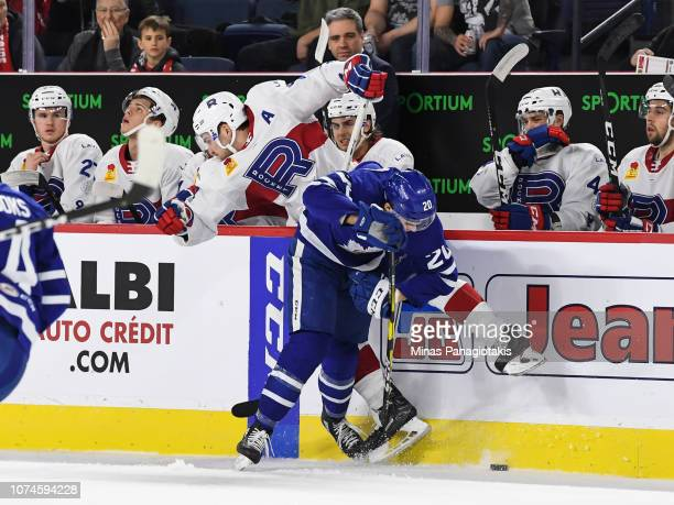 Mason Marchment of Toronto Marlies checks Alexandre Grenier of the Laval Rocket during the AHL game at Place Bell on December 22 2018 in Laval Quebec...