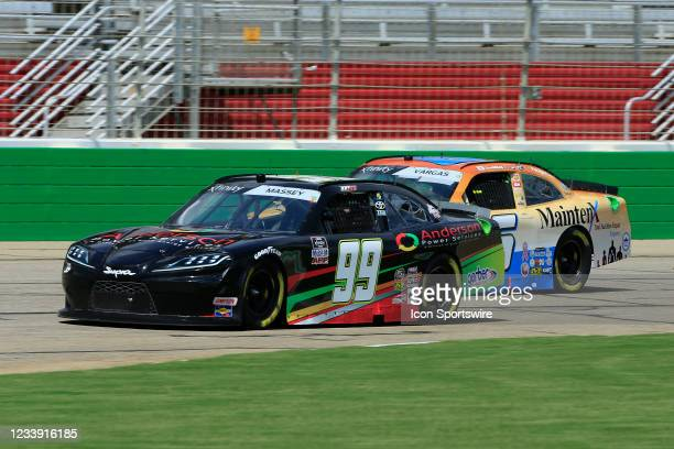 Mason Massey, driver of the Anderson Power Services Ford leads Ryan Vargas, driver of the TeamJDMotorsports.com Chevrolet during the 31st running of...