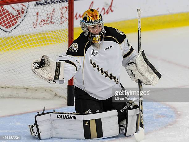 Mason McDonald of the Charlottetown Islanders gloves the puck during the warmup period prior to the QMJHL game against the BlainvilleBoisbriand...
