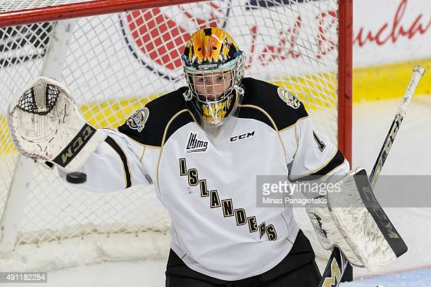 Mason McDonald of the Charlottetown Islanders prepares to glove the puck during the warmup period prior to the QMJHL game against the...