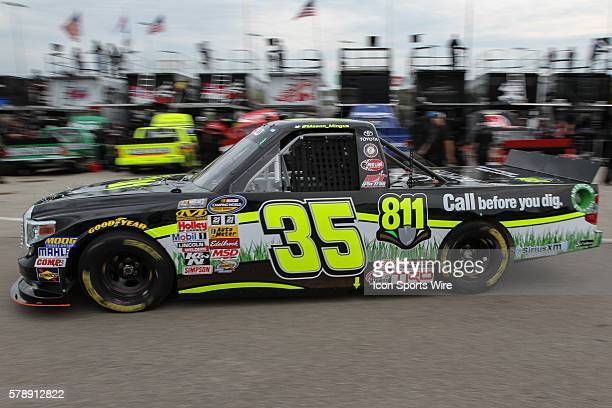 Mason Mingus driver of the No 35 Call 811 Toyota during practice for the NASCAR Camping World Truck Series American Ethanol 200 presented by Enogan...
