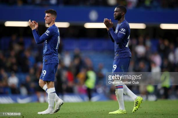 Mason Mount and Fikayo Tomori of Chelsea applaud the fans after the Premier League match between Chelsea FC and Liverpool FC at Stamford Bridge on...
