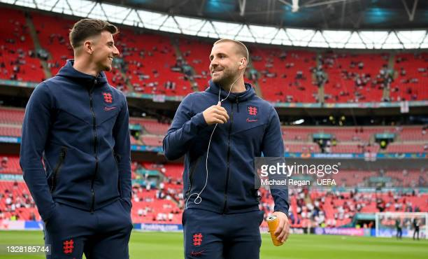 Mason Mount and Luke Shaw of England speak as they inspect the pitch prior to the UEFA Euro 2020 Championship Final between Italy and England at...