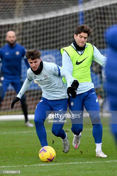 Mason Mount and Marcos Alonso of Chelsea during a training session ahead of the Premier League match against Everton at Chelsea Training Ground on...